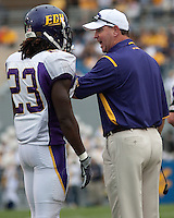 East Carolina head coach Skip Holtz yells at East Carolina defensive back Dekota Marshall. The WVU Mountaineers defeated the East Carolina Pirates 35-20 at Mountaineer Field at Milan Puskar Stadium, Morgantown, West Virginia on September 12, 2009.