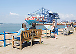 People at Landguard with container ship in background, Port of Felixstowe, Suffolk, England, UK