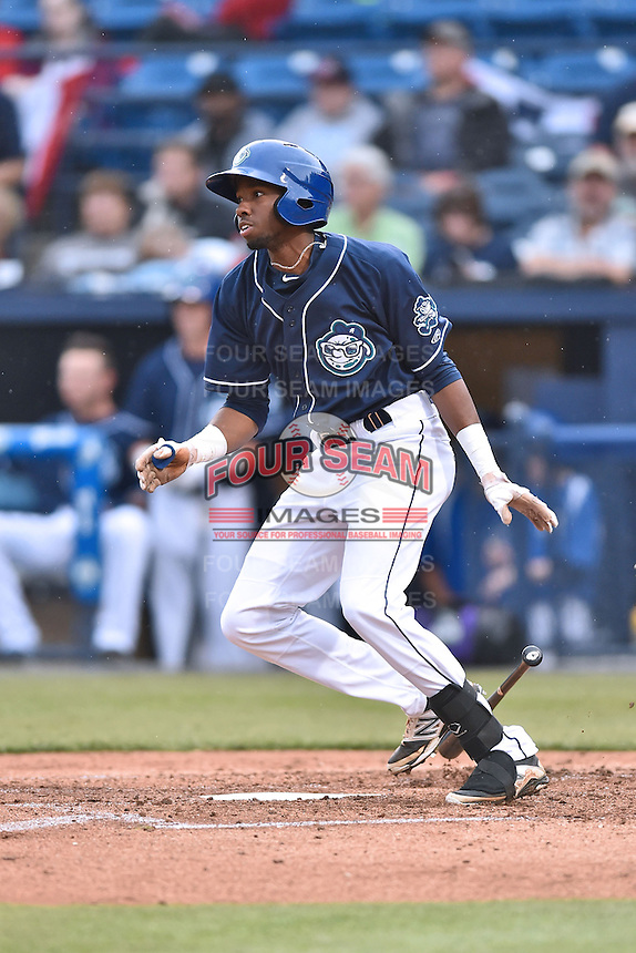Asheville Tourists center fielder Wes Rogers (24) swings at a pitch during game one of a double header against the Greenville Drive on April 18, 2015 in Asheville, North Carolina. The Tourists defeated the Drive 2-1. (Tony Farlow/Four Seam Images)
