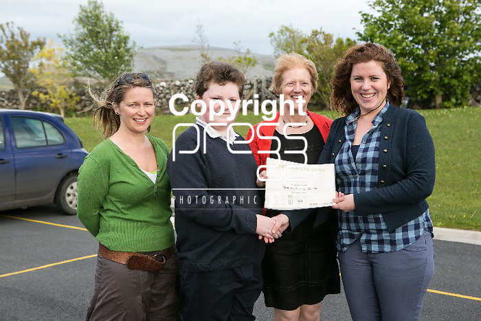 Pictured at the presentation of certificated by EcoEco Beo to students from New Quay National school were: Bridget Barry,Burren Beo Trust, Student Tadhg Leanne,Carmel Thynne, Principal New Quay NS, Aine Bird, Eco Beo Co ordinator . Pictured Credit Brian Gavin Press 22