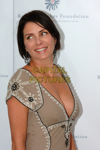 SADIE FROST.Raisa Gorbachev Foundation Launch Party, Althrop, Northamptonshire, England,.10th June 2006..half length beige grey dress low cut cleavage plunging neckline looking back over shoulder.Ref: PL.www.capitalpictures.com.sales@capitalpictures.com.©Capital Pictures