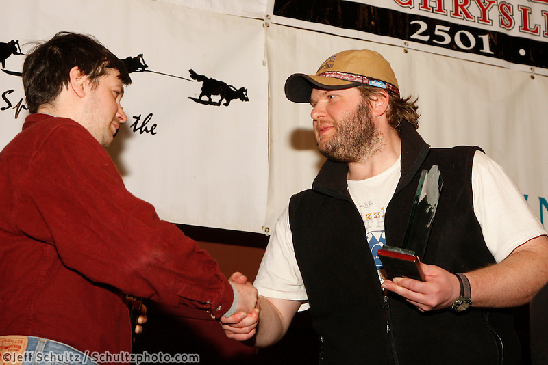 Sunday March 21, 2010   Iditarod official finisher's club president Jim Gallea (L) gives the Fred Meyer sportsmanship award to Ray Redinton Jr. at the musher's finish banquet in Nome .