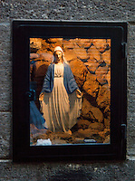 A small statue of the Virgin Mary, built in the wall in the Christian quarter in Damascus, Syria