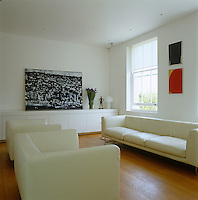 The armchairs and sofa in the living room are by Jasper Morrison for Cappellini and the large painting is by Keith Roberts