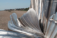 """Scallop"" a sculpture to celebrate Benjamin Britten by Maggie Hambling.  Made specifically for this site on the Suffolk coast which inspired so much of Britten's music.  The phrase, ""I hear those voices that will not be drowned"" (pierced through the steel against the sky), is taken from Britten's opera ""Peter Grimes"", which was itself based on a work by the Aldeburgh poet, George Crabbe."