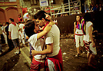 A couple (DIana Bastida and Juan Carlos) kisses before the second run of the bull of the San Fermin Festival, on July 8, 2012, in Pamplona, northern Spain. The festival is a symbol of Spanish culture that attracts thousands of tourists to watch the bull runs despite heavy condemnation from animal rights groups . (c) Pedro ARMESTRE