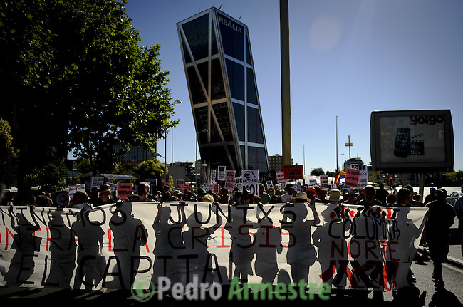 Protesters demonstrate against the euro pact in Madrid on June 19, 2011. Thousands of people began gathering outside the Spanish parliament in Madrid in a new protest against rampant unemployment and biting austerity measures.  (c) PEDRO ARMESTRE