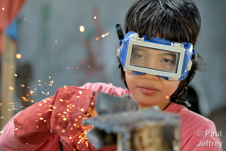 Jeddah Palo grinds smooth a weld as she participates in a welding course at the San Roque Catholic Church in Tolosa, a small town in the Philippines that was devastated by Typhoon Haiyan in 2013. Palo, 24, lost her home to the typhoon's storm surge and has been living with her mother. The 25-day welding course, sponsored by Catholic Relief Services, provides her with training for a new livelihood, while students put their newfound skills to work rebuilding the church's collapsed sanctuary. The storm was known locally as Typhoon Yolanda.