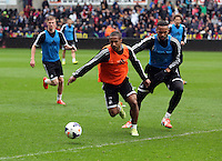 Wednesday, 23 April 2014<br /> Pictured L-R: Wayne Routledge against Kyle Bartley.<br /> Re: Swansea City FC are holding an open training session for their supporters at the Liberty Stadium, south Wales,