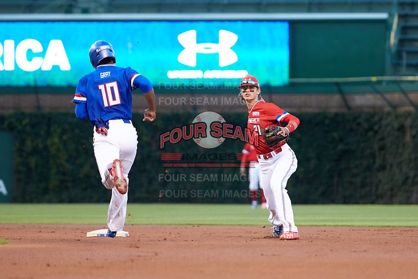 Blaze Alexander (21) of Bishop Verot High School in Cape Coral, Florida throws to first base after forcing Joe Gray (10) out during the Under Armour All-American Game presented by Baseball Factory on July 29, 2017 at Wrigley Field in Chicago, Illinois.  (Jon Durr/Four Seam Images)
