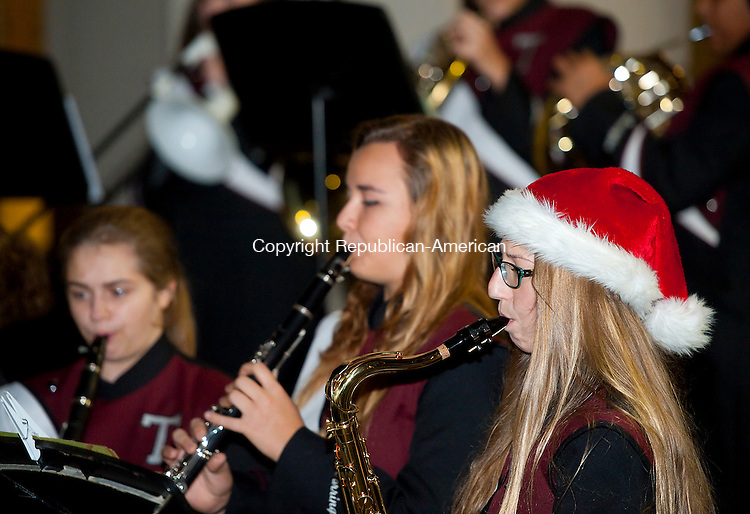 TORRINGTON, CT--- -112715JS03--Members of the Torrington High School Band, including Julia Traub, right, play Christmas tunes during Light Up Main events in downtown Torrington on Friday. Many of the events were hosted by Torrington Parks and Recreation Department.  <br />  Jim Shannon Republican-American