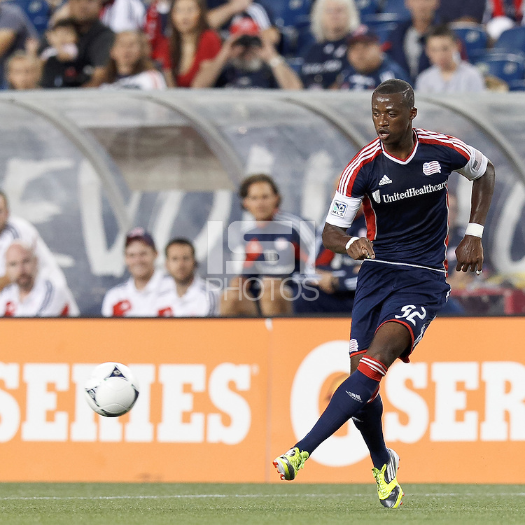 New England Revolution forward Dimitry Imbongo (92) passes the ball. In a Major League Soccer (MLS) match, the New England Revolution defeated Columbus Crew, 2-0, at Gillette Stadium on September 5, 2012.