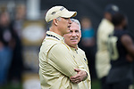 Wake Forest Demon Deacons head coach Dave Clawson (left) chats with assistant head coach Kevin Higgins prior to the game against the Louisville Cardinals at BB&T Field on October 28, 2017 in Winston-Salem, North Carolina.  The Demon Deacons defeated the Cardinals 42-32.  (Brian Westerholt/Sports On Film)