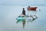 Man paddling a traditional canoe in Funafuti, Tuvalu