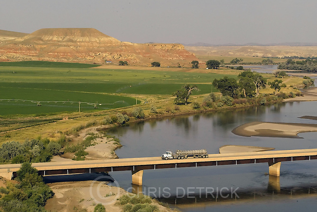 Vernal,Utah--7/20/2005--.An oil truck drives north on US 45 towards, over the Green River, on its way to Vernal...**.Oil and Gas workers alter little town's personality.**.Photo By: Chris Detrick /Salt Lake Tribune.File Number: 816G5842