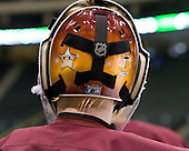 Christian Gaffy (Duluth - 30) remembers a friend who died last year with the friend's initials on the back of his mask. The University of Minnesota-Duluth Bulldogs practiced during the second Frozen Four practice time slot on the Xcel Energy Center ice on Wednesday, April 6, 2011, in St. Paul, Minnesota.