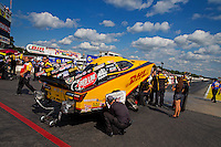 Aug 15, 2014; Brainerd, MN, USA; Crew members with NHRA funny car driver Del Worsham do a final check before the fire-up behind the water box during qualifying for the Lucas Oil Nationals at Brainerd International Raceway. Mandatory Credit: Mark J. Rebilas-