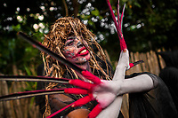 A Salvadoran young man, with blood face paint and long nails, performs an indigenous mythology character in the La Calabiuza parade at the Day of the Dead celebration in Tonacatepeque, El Salvador, 1 November 2016. The festival, known as La Calabiuza since the 90s of the last century, joins Salvador's pre-Hispanic heritage and the mythological figures (La Sihuanaba, El Cipitío, La Llorona etc.) collected from the whole Central American region, together with the catholic All Saints Day holiday and its tradition of honoring the dead relatives. Children and youths only, dressed up in scary costumes and carrying painted carts, march from the local cemetery to the downtown plaza where the party culminates with music, dance, drinking and eating pumpkin (Ayote) with honey.