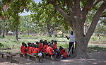Students study in an outdoor classroom in the Loreto Primary School in Rumbek, South Sudan. While the school, run by the Institute for the Blessed Virgin Mary--the Loreto Sisters--of Ireland, focuses on educating girls from throughout the war-torn country, it also educates children from nearby communities.