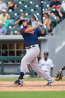 Carlos Rivero (24) of the Pawtucket Red Sox follows through on his swing against the Charlotte Knights at BB&T Ballpark on August 8, 2014 in Charlotte, North Carolina.  The Red Sox defeated the Knights  11-8.  (Brian Westerholt/Four Seam Images)