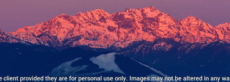 Sunrise glow on the Olympic mountains area in Washington's Olympic National Park. The Olympic Mountains is a year-round destination. In summer, visitors come for views of the Olympic Mountains, as well as for superb hiking. During the winter months the small, family oriented Hurricane Ridge Ski and Snowboard Area offers lift-serviced downhill skiing and snowboarding. Hurricane Ridge is named for its intense gales and winds. The weather in the Olympic Mountains is unpredictable, and visitors should be prepared for snow at any time of year. Jim Bryant Photo. ©2017. All Rights Reserved.
