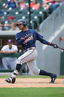 Christian Bethancourt (38) of the Gwinnett Braves follows through on his swing against the Charlotte Knights at BB&T BallPark on July 3, 2015 in Charlotte, North Carolina.  The Braves defeated the Knights 11-4 in game one of a day-night double header.  (Brian Westerholt/Four Seam Images)