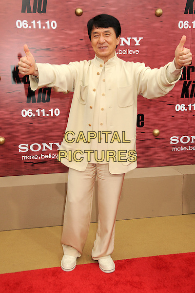 "JACKIE CHAN .""The Karate Kid"" Los Angeles Premiere held at Mann's Village Theatre, Westwood, California, USA,  .7th June 2010..full length beige cream suit jacket hands fingers pointing shirt shoes trousers gesture thumbs up .CAP/ADM/BP.©Byron Purvis/AdMedia/Capital Pictures."