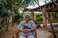 SAO RAIMUNDO NONATO, BRAZIL - FEBRUARY 01, 2014: Ni&egrave;de Guidon, head archaeologist of the Serra da Capivara, national park, sits in her home on February 01, 2014 in Sao Raimundo Nonato, Piaui province, in Northern Eastern Brazil.  Ni&egrave;de Guidon is the head archaeologist at the Serra da Capivara National Park in Piau&iacute;, Brazil where she and her colleagues have discovered over 800 pre-historic sites concerned with the occupation of America by human beings.<br /> <br /> Daniel Berehulak for The New York Times