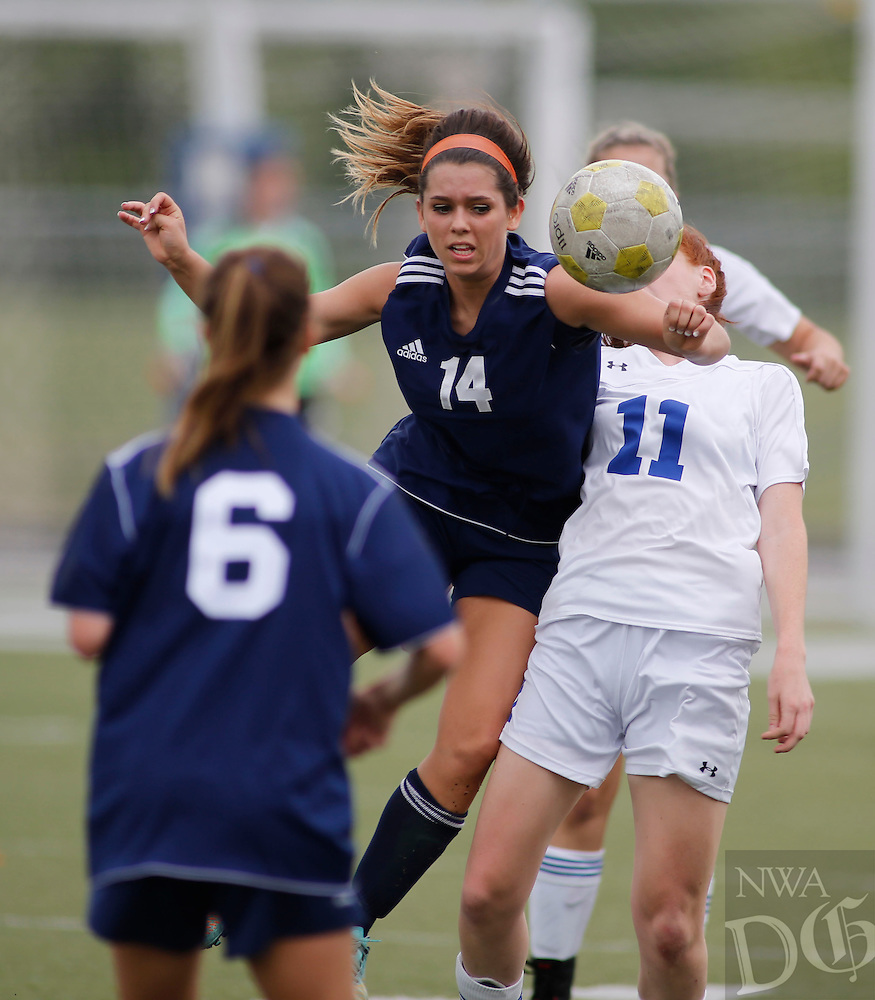 NWA Democrat-Gazette/DAVID GOTTSCHALK - 5/8/15 - Rogers Heritage High School versus Rogers High School Lady Mounties soccer Friday May 8, 2015 at Rogers High Smith Stadium.