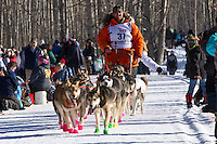 Jake Berkowitz and team run past spectators on the bike/ski trail during the Anchorage ceremonial start during the 2014 Iditarod race.<br /> Photo by Britt Coon/IditarodPhotos.com