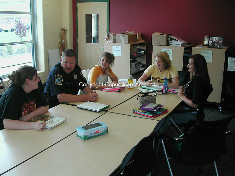 PLYMOUTH, CT - 16 Sept. 2008 - 091608KM02 - School Resource Officer Kevin Sulek talks with Terryville High School students, from left to right, Nicole Huria, Joleen Lizotte, Megan Smith and Alivia Rhault. Sulek is back as the school resource officer after staff shortages and budget cuts eliminated the position for more than a year. Kurt Moffett Republican-American