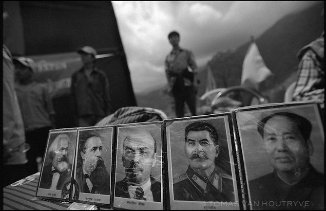 Photos of communist icons Marx, Engels, Lenin, Stalin and Mao form part of the decorations for the inauguration ceremony for the Maoist rebel &quot;Martyr's Road,&quot; celebrating the opening of the first section of the road in Tila, Nepal on 24 June, 2005.<br />