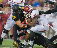 NWA Democrat-Gazette/JASON IVESTER<br /> Arkansas running back Rawleigh Williams (22) is stopped short of the goal line by Missouri Tigers linebacker Eric Beisel (38) on Friday, Nov. 25, 2016, at Faurot Field in Columbia, Mo., during the fourth quarter.