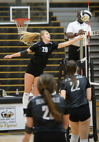 NWA Democrat-Gazette/ANDY SHUPE<br /> Bentonville's Savanna Riney (20) sends the ball over the net Tuesday, Sept. 10, 2019, during play against Van Buren in Tiger Arena in Bentonville. Visit nwadg.com/photos to see more photos from the match.