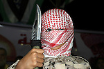 A Palestinian protester holds a knife during a protest to support the third Palestinian uprising, in Rafah in the southern Gaza Strip November 13, 2015. The current wave of violence erupted in mid-September, fueled by rumors that Israel was trying to increase Jewish presence in Jerusalem then quickly spread across Israel, the West Bank and the Gaza Strip. Photo by Abed Rahim Khatib