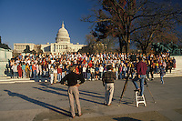 AJ2269, U.S. Capitol, Washington, DC, District of Columbia, capitol, capital, A group of students stand on the steps posing for a photographer taking a picture in front of The United States Capitol Building in Washington, D.C.