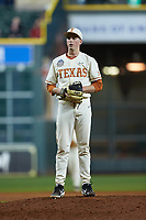 Texas Longhorns relief pitcher Pete Hansen (33) looks to his catcher for the sign against the Arkansas Razorbacks in game six of the 2020 Shriners Hospitals for Children College Classic at Minute Maid Park on February 28, 2020 in Houston, Texas. The Longhorns defeated the Razorbacks 8-7. (Brian Westerholt/Four Seam Images)
