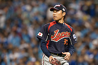17 March 2009: #31 Shunsuke Watanabe of Japan comes back to the dugout during the 2009 World Baseball Classic Pool 1 game 4 at Petco Park in San Diego, California, USA. Korea wins 4-1 over Japan.
