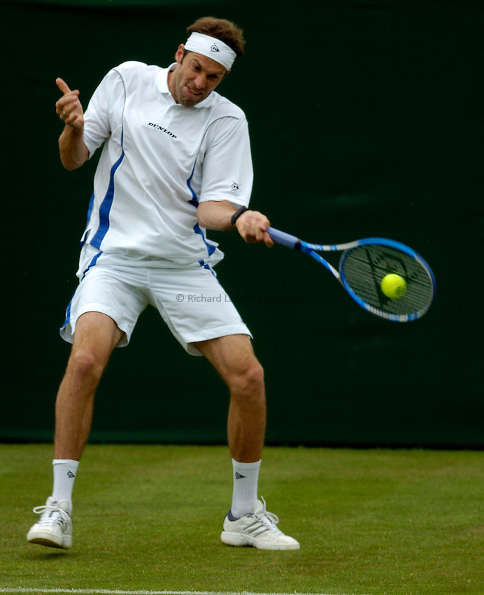 Photo: Richard Lane..Wimbledon Championships. 27/06/2006. .Great Britain's Greg Rusedski returns.