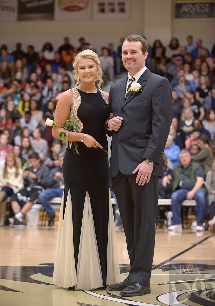 NWA Democrat-Gazette/BEN GOFF @NWABENGOFF<br /> Julia Jeffrey takes the floor on Friday Jan. 15, 2016 during Bentonville High's colors day ceremony at halftime in the boys basketball game against Springdale Har-Ber in Bentonville's Tiger Arena.