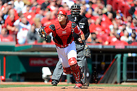 Cincinnati Reds catcher Devin Mesoraco #39 looks for a foul pop up in front of umpire Brian O'Nora during a game against the Miami Marlins at Great American Ball Park on April 20, 2013 in Cincinnati, Ohio.  Cincinnati defeated Miami 3-2 in 13 innings.  (Mike Janes/Four Seam Images)