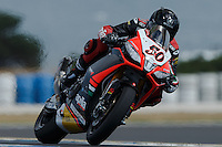 Sylvain Guintoli (FRA) riding the Aprilia RSV4 1000 Factory (50) of the Aprilia Racing Team exits turn 6 during a qualifying session on day one of round one of the 2013 FIM World Superbike Championship at Phillip Island, Australia.