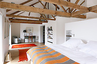 The restoration of the master bedroom involved revealing the original roof beams which have now become a feature of the room
