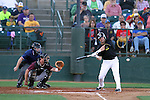 SIOUX FALLS, SD - AUGUST 2:  Jared Clark #15 from the Sioux Falls Canaries eyes the baseball in front of catcher Petey Paramore #25 from the Kansas City T-Bones defends in the second inning Friday night at the Sioux Falls Stadium. (Photo by Dave Eggen/Inertia)