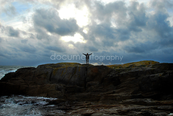 A man standing up on the rocks in Carnac, 2006..© Magali Corouge/ Documentography