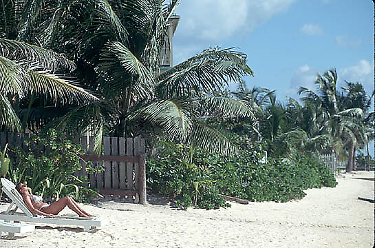 Woman relaxing on beach in southern Belize