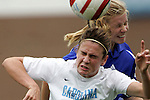 09 October 2005: Carolina's Heather O'Reilly and Duke's Kelly McCann challenge for a header. The Duke Blue Devils defeated the #1 ranked Carolina Tar Heels 2-1 at Fetzer Field in Chapel Hill, North Carolina in a regular season Atlantic Coast Conference women's soccer game.