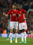 Michael Carrick of Manchester United talks to Paul Pogba of Manchester United during the Europa League Semi Final 2nd Leg match at Old Trafford Stadium, Manchester. Picture date: May 11th 2017. Pic credit should read: Simon Bellis/Sportimage