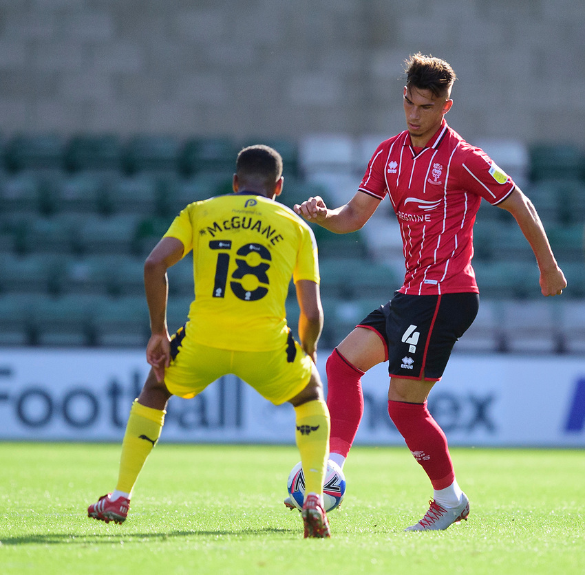 Lincoln City's Lewis Montsma vies for possession with Oxford United's Cameron Brannagan<br /> <br /> Photographer Andrew Vaughan/CameraSport<br /> <br /> The EFL Sky Bet League One - Saturday 12th September  2020 - Lincoln City v Oxford United - LNER Stadium - Lincoln<br /> <br /> World Copyright © 2020 CameraSport. All rights reserved. 43 Linden Ave. Countesthorpe. Leicester. England. LE8 5PG - Tel: +44 (0) 116 277 4147 - admin@camerasport.com - www.camerasport.com - Lincoln City v Oxford United