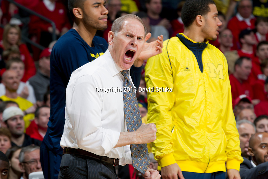 Michigan Wolverines Head Coach John Beilein reacts to an official's call during a Big Ten Conference NCAA college basketball game against the Wisconsin Badgers Saturday, February 9, 2013, in Madison, Wis. The Badgers won 65-62 (OT) (Photo by David Stluka)
